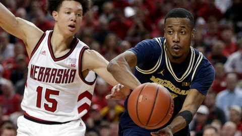 Michigan's Muhammad-Ali Abdur-Rahkman, right, passes the ball while defended by Nebraska's Isaiah Roby (15) during the first half of an NCAA college basketball game in Lincoln, Neb., Thursday, Jan. 18, 2018. (AP Photo/Nati Harnik)