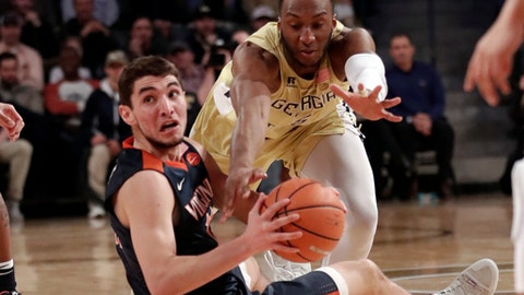 Virginia guard Ty Jerome (11) comes up with the ball against Georgia Tech guard Josh Okogie (5) during the first second of an NCAA college basketball game Thursday, Jan. 18, 2018, in Atlanta. (AP Photo/John Bazemore)