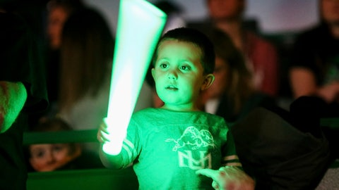 A young waves a glow stick as Marshall takes on Middle Tennessee during an NCAA basketball college basketball game Thursday, Jan. 18, 2018, in Huntington, W.Va. (Sholten Singer/The Herald-Dispatch via AP)