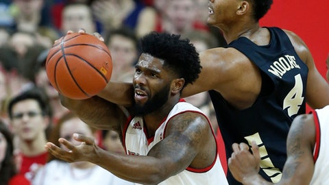 North Carolina State's Lennard Freeman (1) pulls in the rebound from Wake Forest's Doral Moore (4) during the first half of an NCAA college basketball game in Raleigh, N.C., Thursday, Jan. 18, 2018. (Ethan Hyman/The News & Observer via AP)