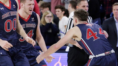 Saint Mary's guard Cullen Neal (44) celebrates with center Jock Landale, center, after the team's 74-71 win over Gonzaga in an NCAA college basketball game in Spokane, Wash., Thursday, Jan. 18, 2018. (AP Photo/Young Kwak)