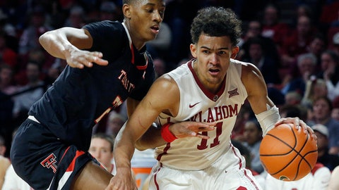 FILE - In this Tuesday, Jan. 9, 2018 file photo, Oklahoma's Trae Young (11) drives the ball past Texas Tech's Jarrett Culver (23) during the second half of an NCAA college basketball game in Norman, Okla. Oklahoma's Trae Young, Duke's Marvin Bagley III and Arizona's Deandre Ayton lead the list of top performers in college basketball as the season crosses its midway point. (AP Photo/Garett Fisbeck, File)