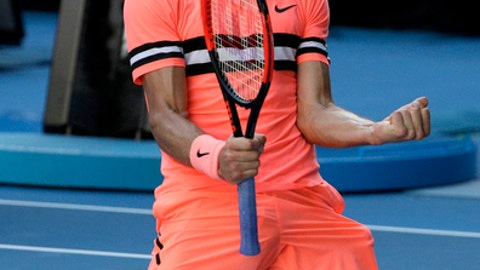 Bulgaria's Grigor Dimitrov celebrates after defeating Russia's Andrey Rublev in their third round match at the Australian Open tennis championships in Melbourne, Australia, Friday, Jan. 19, 2018. (AP Photo/Dita Alangkara)