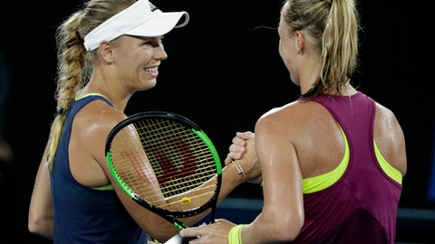 Denmark's Caroline Wozniacki, left, is congratulated by Kiki Bertens of the Netherlands after winning their third round match at the Australian Open tennis championships in Melbourne, Australia, Saturday, Jan. 20, 2018. (AP Photo/Dita Alangkara)