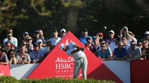 Dustin Johnson of the United States tees off on the 16th hole during the second round of the Abu Dhabi Championship golf tournament in Abu Dhabi, United Arab Emirates, Friday, Jan. 19, 2018. (AP Photo/Kamran Jebreili)