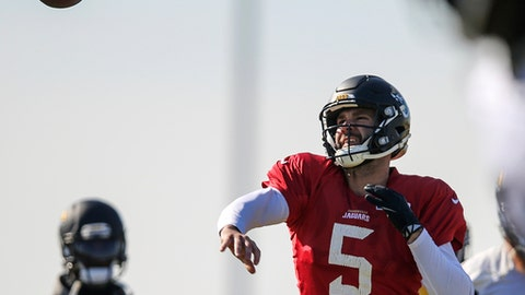 Jacksonville Jaguars quarterback Blake Bortles (5) throws a pass during an NFL football practice in Jacksonville, Fla., Friday, Jan. 19, 2018. (AP Photo/Gary McCullough)