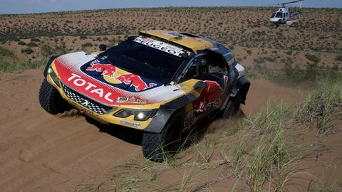 Driver Stephane Peterhansel, of France, and co-driver Jean Paul Cottret, of France, race their Peugeot during stage 13 of the 2018 Dakar Rally between San Juan and Cordoba, Argentina, Friday, Jan. 19, 2018. (AP Photo/Ricardo Mazalan)