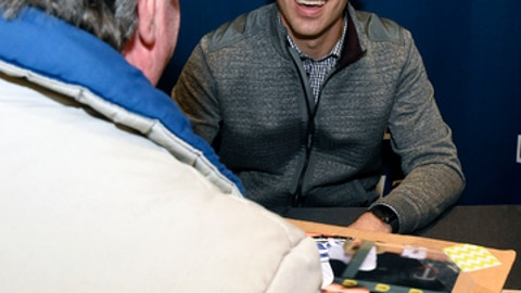 Minnesota Twins' Joe Mauer signs an autograph during the baseball team's TwinsFest on Friday, Jan. 19, 2018, in Minneapolis. (AP Photo/Hannah Foslien)