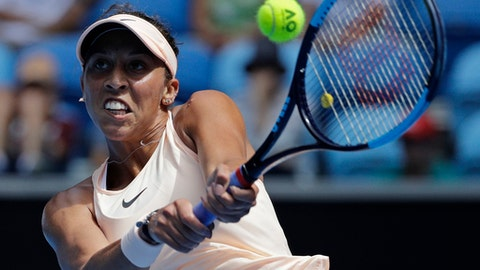 United States' Madison Keys makes a backhand return to Romania's Ana Bogdan during their third round match at the Australian Open tennis championships in Melbourne, Australia, Saturday, Jan. 20, 2018. (AP Photo/Dita Alangkara)