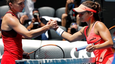 Top seed Halep back from brink to reach last 16