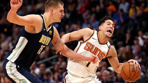 DENVER, CO - JANUARY 19: Devin Booker #1 of the Phoenix Suns drives to the basket against Nikola Jokic #15 of the Denver Nuggets at the Pepsi Center on January 19, 2018 in Denver, Colorado. NOTE TO USER: User expressly acknowledges and agrees that, by downloading and or using this photograph, User is consenting to the terms and conditions of the Getty Images License Agreement.  (Photo by Matthew Stockman/Getty Images)