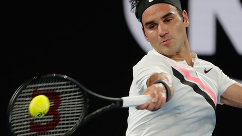 Switzerland's Roger Federer makes forehand return to France's Richard Gasquet during their third round match at the Australian Open tennis championships in Melbourne, Australia, Saturday, Jan. 20, 2018. (AP Photo/Vincent Thian)