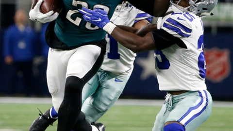 FILE - In this Nov. 19, 2017, file photo, Philadelphia Eagles running back LeGarrette Blount (29) breaks a tackle attempt by Dallas Cowboys' Xavier Woods (25)  in the second half of an NFL football game, in Arlington, Texas. When Chris Long and LeGarrette Blount arrived in Philadelphia after winning a Super Bowl with New England last season, they brought much-needed veteran leadership and experience. Both players have played key roles in helping the Eagles reach the NFC championship game. (AP Photo/Michael Ainsworth, File)