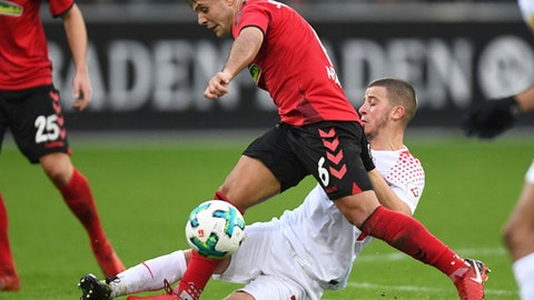 Freiburg's Amir Abrashi, front, and Leipzig's Diego Demme challenge for the ball during the German first division Bundesliga soccer match between SC Freiburg and RB Leipzig in Freiburg, Germany, Saturday, Jan. 20, 2018. (Patrick Seeger/dpa via AP) via AP)