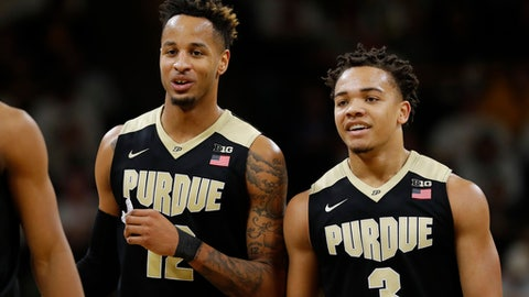 Purdue forward Vincent Edwards, left, reacts with teammate Carsen Edwards during the second half of an NCAA college basketball game against Iowa, Saturday, Jan. 20, 2018, in Iowa City, Iowa. Carson Edwards scored 22 points as Purdue won 87-64. (AP Photo/Charlie Neibergall)