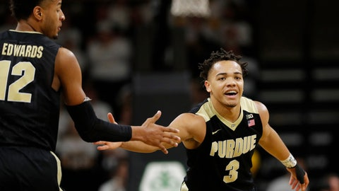 Purdue guard Carsen Edwards, right, celebrates with teammate Vincent Edwards, left, after making a 3-point basket during the second half of an NCAA college basketball game against Iowa, Saturday, Jan. 20, 2018, in Iowa City, Iowa. Carsen Edwards scored 22 points as Purdue won 87-64. (AP Photo/Charlie Neibergall)