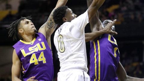 Vanderbilt guard Saben Lee (0) drives against LSU defenders Wayde Sims (44) and Duop Reath (1) in the first half of an NCAA college basketball game Saturday, Jan. 20, 2018, in Nashville, Tenn. (AP Photo/Mark Humphrey)