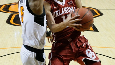 Oklahoma guard Trae Young (11) goes to the basket as Oklahoma State guard Tavarius Shine, left, defends, in the first half of an NCAA college basketball game in Stillwater, Okla., Saturday, Jan. 20, 2018. (AP Photo/Sue Ogrocki)