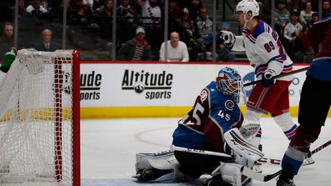 New York Rangers right wing Pavel Buchnevich (89) pumps his fist after scoring a goal against Colorado Avalanche goaltender Jonathan Bernier (45) in the second period of an NHL hockey game in Denver on Saturday, Jan. 20, 2018.(AP Photo/Joe Mahoney)