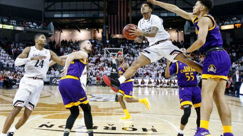Cincinnati's Cane Broome, center right, shoots against ECU's Justin Whatley, right, in the first half of an NCAA college basketball game, Saturday, Jan. 20, 2018, in Highland Heights, Ky. (AP Photo/John Minchillo)