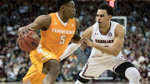 Tennessee forward Admiral Schofield (5) drives to the hoop against South Carolina forward Justin Minaya (10) during the first half of an NCAA college basketball game Saturday, Jan. 20, 2018, in Columbia, S.C. (AP Photo/Sean Rayford)