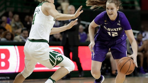 Baylor guard Kristy Wallace, left, of Australia, defends as Kansas State guard Rachel Ranke (12) looks for an opening to the basket during the first half of an NCAA college basketball game Saturday, Jan. 20, 2018, in Waco, Texas. (AP Photo/Tony Gutierrez)
