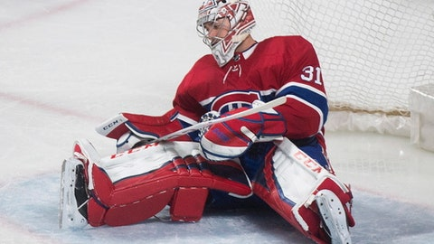 Montreal Canadiens goaltender Carey Price reacts on a disallowed goal by Boston Bruins' Patrice Bergeron during the third period of an NHL hockey game in Montreal, Saturday, Jan. 20, 2018. (Graham Hughes/The Canadian Press via AP)