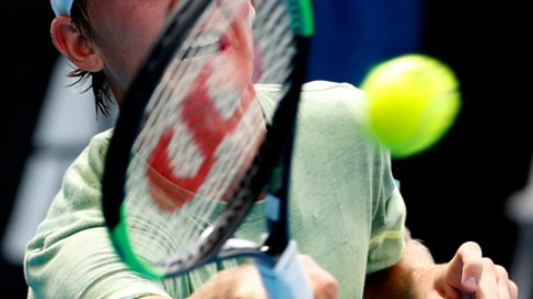 United States' Sebastian Korda makes a forehand return to France's Clement Tabur during their boy's singles match at the Australian Open tennis championships in Melbourne, Australia, Sunday, Jan. 21, 2018. Sebastian, the son of 1998 Australian Open champion Petr Korda, got his own debut Australian Open campaign off to a promising start, however, winning his opening matches in both the boys' singles and doubles competitions on Sunday. (AP Photo/Ng Han Guan)