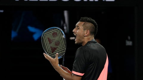 Australia's Nick Kyrgios yells in frustration during his fourth round match against Bulgaria's Grigor Dimitrov at the Australian Open tennis championships in Melbourne, Australia Sunday, Jan. 21, 2018. (AP Photo/Dita Alangkara)