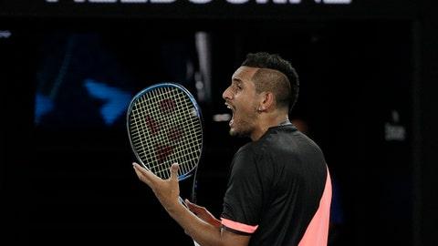 Australia's Nick Kyrgios yells in frustration during his fourth round match against Bulgaria's Grigor Dimitrov at the Australian Open tennis championships in Melbourne, Australia Sunday, Jan. 21, 2018. (AP Photo/Dita Alangkara)