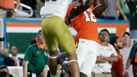 Miami defensive back Malek Young (12) defends a pass intended for Notre Dame wide receiver Kevin Stepherson (29) during the first half of an NCAA college football game, Saturday, Nov. 11, 2017, in Miami Gardens, Fla. (AP Photo/Lynne Sladky)