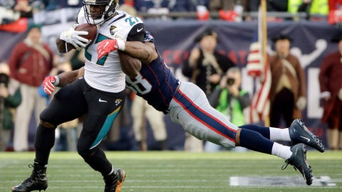 New England Patriots defensive end Trey Flowers (98) tackles Jacksonville Jaguars running back Leonard Fournette (27) during the first half of the AFC championship NFL football game, Sunday, Jan. 21, 2018, in Foxborough, Mass. (AP Photo/Steven Senne)