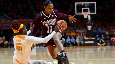 Tennessee forward Cheridene Green (15) hits the ball away from Mississippi State guard Roshunda Johnson (11) in the first half of an NCAA college basketball game Sunday, Jan. 21, 2018, in Knoxville, Tenn. (AP Photo/Crystal LoGiudice)