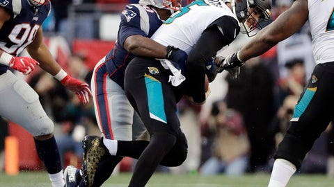 Jacksonville Jaguars quarterback Blake Bortles is sacked by New England Patriots defensive tackle Adam Butler, rear, during the first half of the AFC championship NFL football game, Sunday, Jan. 21, 2018, in Foxborough, Mass. (AP Photo/David J. Phillip)