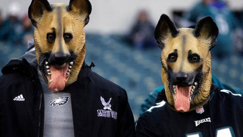 Philadelphia Eagles fans dressed as underdogs watch as players start to warm up before the NFL football NFC championship game against the Minnesota Vikings Sunday, Jan. 21, 2018, in Philadelphia. (AP Photo/Michael Perez)