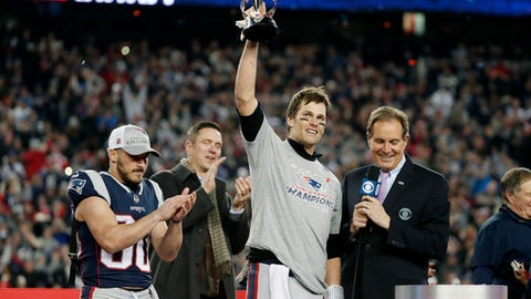 New England Patriots quarterback Tom Brady holds the AFC championship trophy after an NFL football game, Sunday, Jan. 21, 2018, in Foxborough, Mass. The Patriots won 24-20. (AP Photo/Winslow Townson)