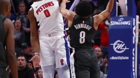 DETROIT, MI - JANUARY 21: Spencer Dinwiddie #8 of the Brooklyn Nets makes the game winning shot around Andre Drummond #0 of the Detroit Pistons at Little Caesars Arena on January 21, 2018 in Detroit, Michigan. Brooklyn won the game 101-100. NOTE TO USER: User expressly acknowledges and agrees that, by downloading and or using this photograph, User is consenting to the terms and conditions of the Getty Images License Agreement. (Photo by Gregory Shamus/Getty Images)