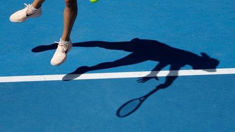 France's Caroline Garcia serves to United States' Madison Keys during their fourth round match at the Australian Open tennis championships in Melbourne, Australia Monday, Jan. 22, 2018. (AP Photo/Dita Alangkara)