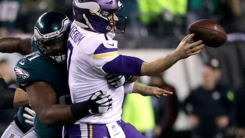 Philadelphia Eagles' Fletcher Cox hits Minnesota Vikings' Case Keenum as he throws during the second half of the NFL football NFC championship game Sunday, Jan. 21, 2018, in Philadelphia. (AP Photo/Michael Perez)