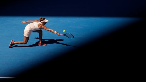 United States' Madison Keys makes a backhand return to France's Caroline Garcia during their fourth round match at the Australian Open tennis championships in Melbourne, Australia, Monday, Jan. 22, 2018. (AP Photo/Dita Alangkara)