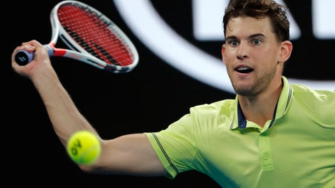 Austria's Dominic Thiem makes a forehand return to United States' Tennys Sandgren during their fourth round match at the Australian Open tennis championships in Melbourne, Australia, Monday, Jan. 22, 2018. (AP Photo/Vincent Thian)