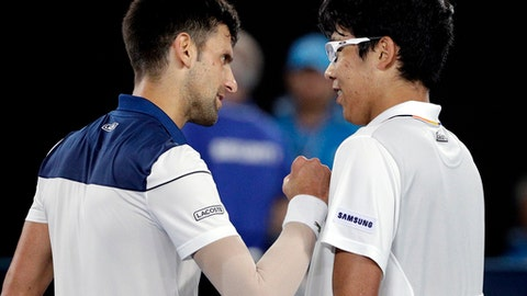 South Korea's Chung Hyeon, right, is congratulated by Serbia's Novak Djokovic after winning their fourth round match at the Australian Open tennis championships in Melbourne, Australia, Monday, Jan. 22, 2018. (AP Photo/Dita Alangkara)