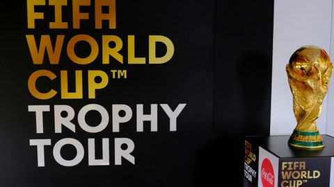 The FIFA World Cup trophy stands on a pedestal on board an aircraft on the first leg of the soccer FIFA Wold Cup 2018 trophy tour at Stansted Airport, England, Monday, Jan. 22, 2018. The trophy will visit some 50 countries as it make its journey round the world to Moscow for the start of the World Cup 2018 in Russia. (AP Photo/Alastair Grant)