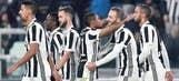 Juventus beats Genoa 1-0 to trail Napoli by 1 point