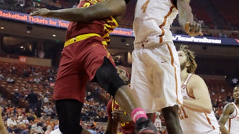Iowa State forward Cameron Lard (2) tries to shoot past Texas forward Mohamed Bamba (4) during the first half of an NCAA college basketball game, Monday, Jan. 22, 2018, in Austin, Texas. (AP Photo/Eric Gay)