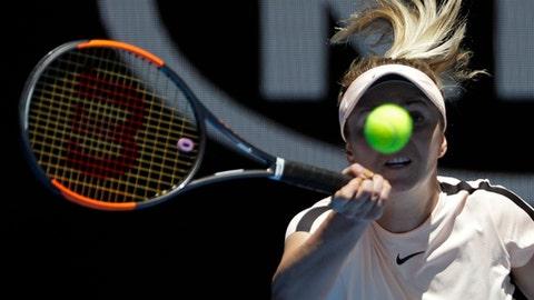 Ukraine's Elina Svitolina makes a forehand return to Belgium's Elise Mertens during their quarterfinal at the Australian Open tennis championships in Melbourne, Australia, Tuesday, Jan. 23, 2018. (AP Photo/Dita Alangkara)