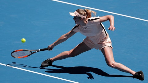 Ukraine's Elina Svitolina reaches for a return to Belgium's Elise Mertens during their quarterfinal at the Australian Open tennis championships in Melbourne, Australia, Tuesday, Jan. 23, 2018. (AP Photo/Vincent Thian)