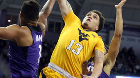 TCU guard Desmond Bane (1) tries to defend against the shot by West Virginia forward Teddy Allen (13) in the first half of an NCAA college basketball game in Fort Worth, Texas, Monday, Jan. 22, 2018. (AP Photo/ Richard W. Rodriguez)