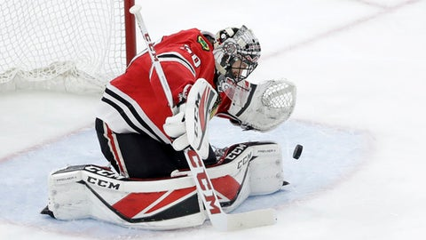 Chicago Blackhawks goaltender Jeff Glass makes a save during the second period of an NHL hockey game against the Tampa Bay Lightning, Monday, Jan. 22, 2018, in Chicago. (AP Photo/Charles Rex Arbogast)