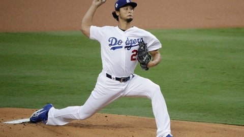 "FILE - In this Nov. 1, 2017, file photo, Los Angeles Dodgers starting pitcher Yu Darvish, of Japan, throws against the Houston Astros during the first inning of Game 7 of baseball's World Series in Los Angeles. Free agent pitcher Darvish said Monday, Dec. 18, he had a ""very good meeting"" with the Chicago Cubs. Darvish tweeted a statement in Japanese confirming the meeting amid reports that Cubs executives Theo Epstein and Jed Hoyer were in Dallas to speak with the right-hander. (AP Photo/Jae C. Hong, File)"